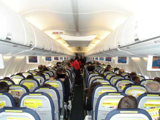 Sardinian sun tuifly 39 s shiny new 737 700s meridiana 39 s for Can service dogs fly in cabin